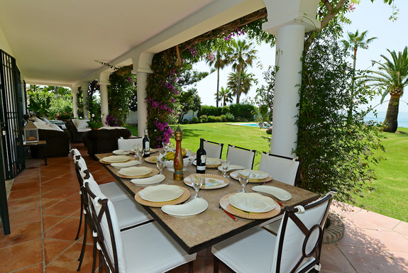 Enjoy the warm sea breeze while dining on the terrace at La Calma