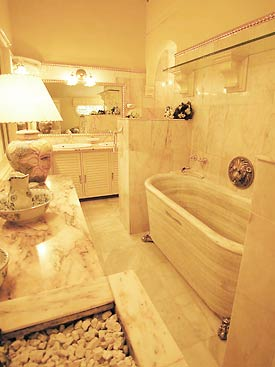 The bathroom features a solid marble bath from Sean Connery's old property at Marbella