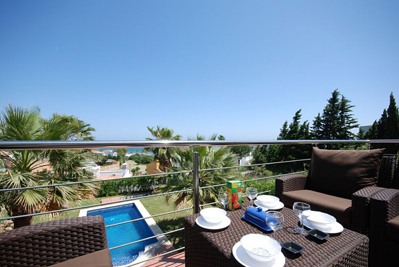 Breakfast on the terrace overlooking the pool at Casa la Colina, Estepona