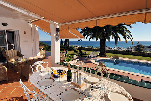 The outdoor dining table at Casa Cuig enjoys great sea views