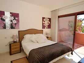 The bright and airy double bedroom opens onto the front terrace at Menara Beach, Estepona