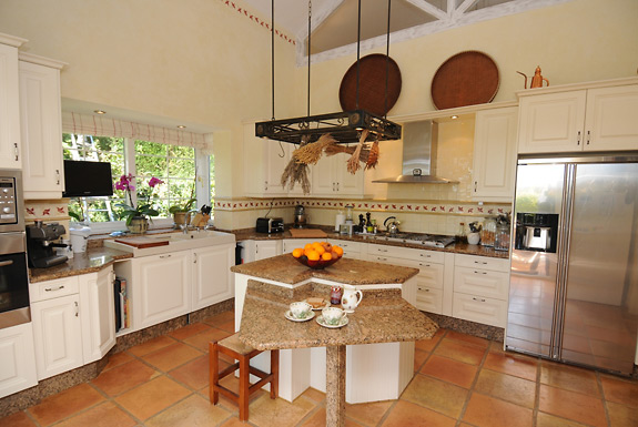 The modern kitchen is well equipped at Villa Miren, Marbella