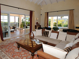The spacious lounge opens out onto the covered terrace at Villa Miren, Marbella, Nueva Andalucia