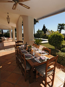 Outside the kitchen is a dining table at Villa Miren, Puerto Banus
