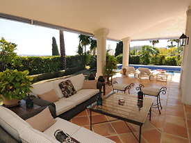 The outside terrace has plentiful comfy seating at Villa Miren